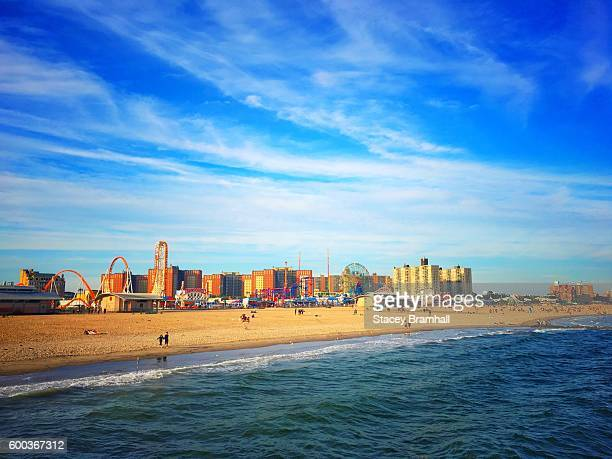 coney island beach and amusement parks in brooklyn, ny on a summer day - coney island stock pictures, royalty-free photos & images