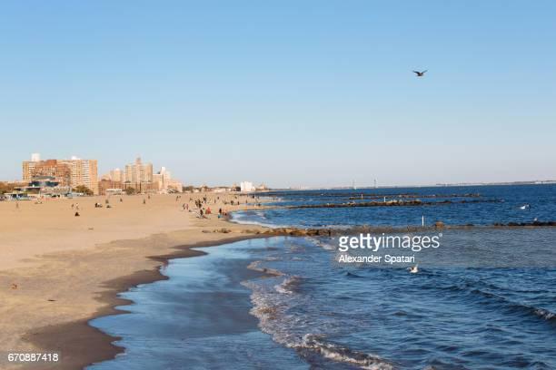 Coney Island beach on a sunny day, Brooklyn, New York City, USA
