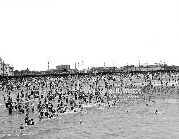 Coney Island beaches in Brooklyn were thronged with New York folks who sought to escape the fury of the terrific heat wave that gripped the city New...