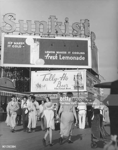 Coney Island boardwalk, Sunkist Lemonade and Tally-Ho Beer billboards, New York, New York, 1929.