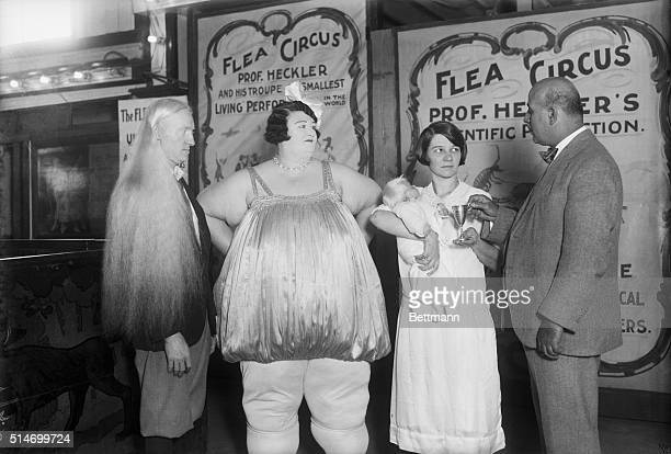 Coney Island freak show An albino photographed with fat lady Flea Circus Poster in background BPA2# 680