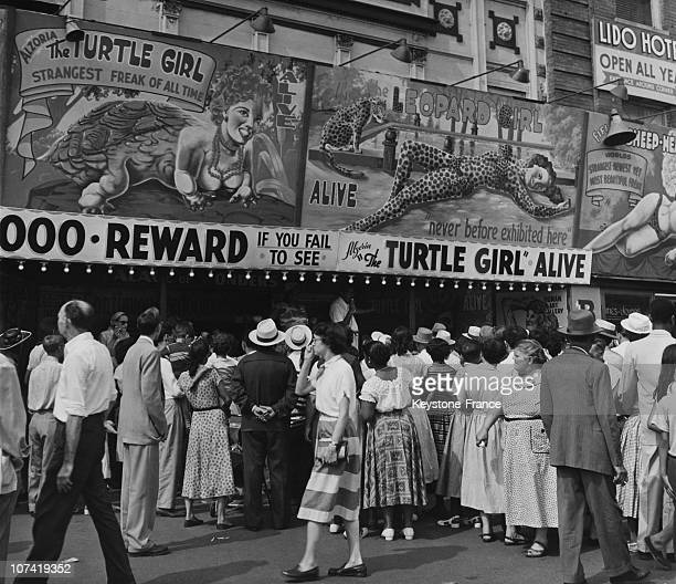 Coney Island, People Standing In Line To See A Freak Show At New York In Usa