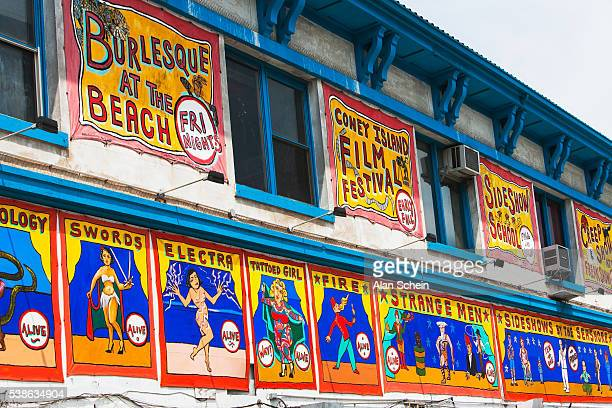coney island, signs, freak show signs - burlesque stock pictures, royalty-free photos & images