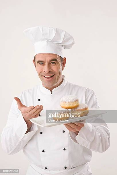 Confectioner presenting pastries on a porcelain plate