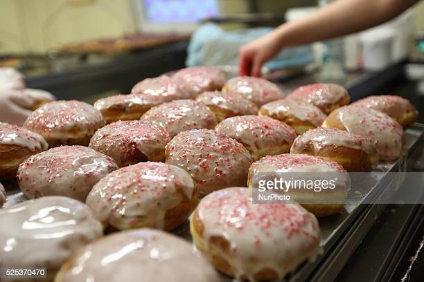 Confectioners and bakers in T Deker confectionery made over 12000 donuts this night Fat Thursday is a traditional Christian feast on the last...