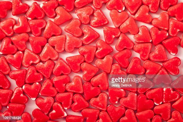 confectionery hearts - candy heart stock pictures, royalty-free photos & images