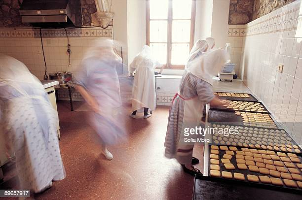 Confectionery of Santa Clara´s monastery A group of nuns prepares cookies in the kitchen of Santa Clara´s monastery. Burgos province