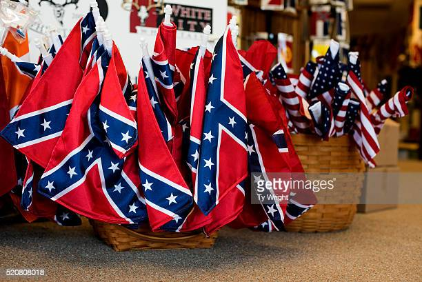 Confederate and American flags are displayed inside of the showcase room at Alabama Flag and Banner where Confederate flags are manufactured on April...