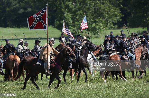 Confederate and Union cavalry reenactors skirmish during a reenactment of the 150th anniversary of the Battle of Gettysburg on June 29 2013 in...