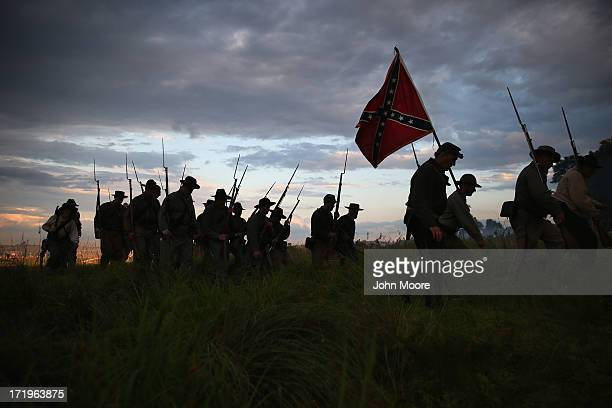 Confederate Civil War re-enactors march for an evening attack during a three-day Battle of Gettysburg re-enactment on June 29, 2013 in Gettysburg,...
