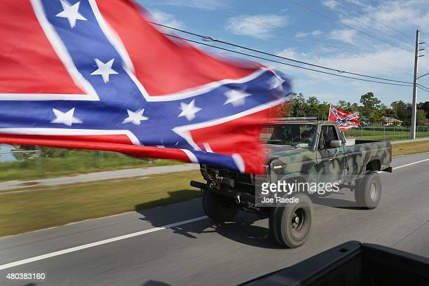 Confederate flag flies from a vehicle during a rally to show support for the American and Confederate flags on July 11 2015 in Loxahatchee Florida...