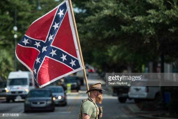 Confederate flag supporter arrives at the South Carolina Statehouse on July 10, 2017 in Columbia, South Carolina. To mark the two year anniversary of...