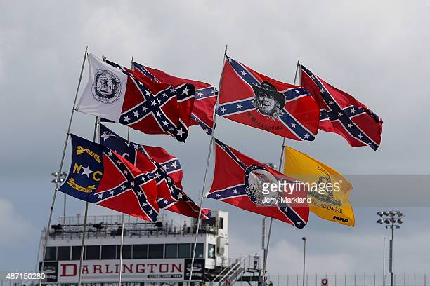 Confederate flags are seen flying over the infield campground prior to the NASCAR Sprint Cup Series Bojangles' Southern 500 at Darlington Raceway on...