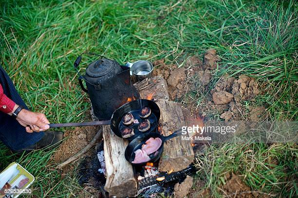Confederate forces make cook breakfast sausage and bacon on a campfire during the 150th Antietam Civil War Reenactment in Boonsboro MD on September 8...
