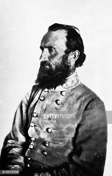 """Confederate General """"Stonewall"""" Jackson earned his nickname at the first battle of Bull Run where he and his men defended themselves by standing like..."""