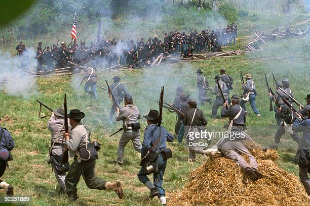 confederate infantry civil war charge against union position - historical reenactment stock photos and pictures