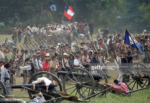 Confederate infantry reenactors advance on Union lines during the second day of the reenactment of the Civil War's First Battle of Bull Run outside...