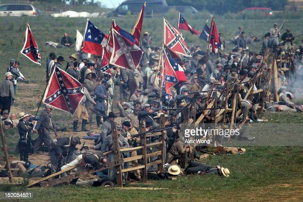 Confederate infantry reenactors participate in the Battle of Bloody Lane during an event to mark the 150th anniversary of the Battle of Antietam...