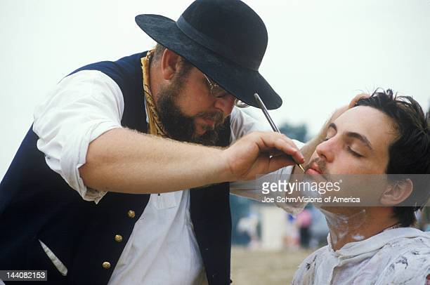 Confederate participants shaving in camp scene during recreation of Battle of Manassas marking the beginning of the Civil War