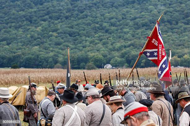 Confederate Soldiers in Military Uniform With Flags and Rifles Marching to the Battlefield During the 150th Anniversary of the Historic Battle of...
