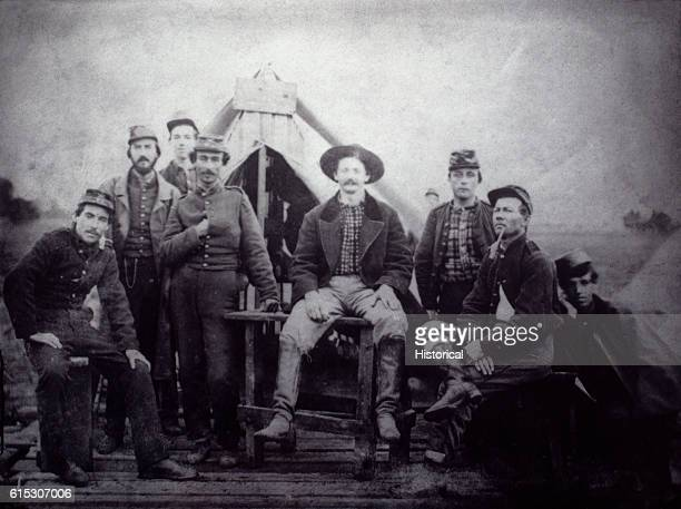 Confederate soldiers pose outside a tent during the American Civil War The soldier at right wears a mess plate on his head | Location Confederate...