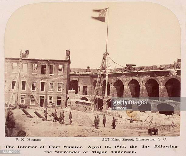 Confederate soldiers stand beneath the Stars and Bars at Fort Sumter South Carolina on April 15 the day after the Union surrendered the fort