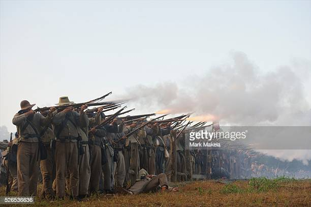 Confederate troops open fire during a dawn battle at the 150th Antietam Civil War Reenactment weekend in Boonsboro, Maryland on September 9, 2012.