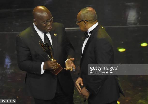 Confederation of African Football President Ahamad Ahmad presents Platinium award to Ghanaian President Nana AkufoAddo during the award ceremony at...