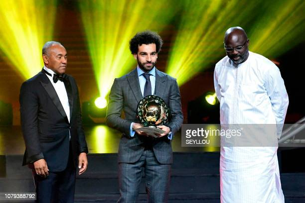 TOPSHOT Confederation of African Football President Ahmad Ahmad poses after he handovered the 2018 African Footballer of the Year Award also called...