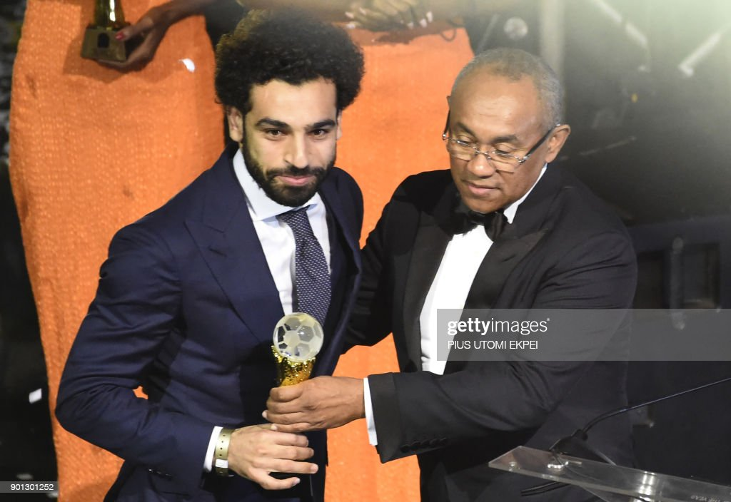 TOPSHOT - Confederation of African Football (CAF) President Ahmad Ahmad (R) presents The African Footballer of the Year Award to Egypt and Liverpool striker Mohamed Salah during an award ceremony at the International Conference Centre in Accra on January 4, 2018. /
