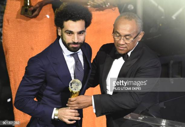 TOPSHOT Confederation of African Football President Ahmad Ahmad presents The African Footballer of the Year Award to Egypt and Liverpool striker...