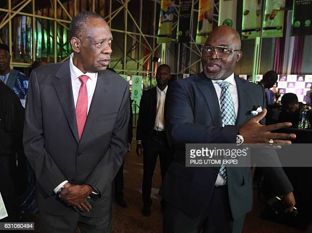Confederation of African Football President Issa Hayatou speaks with Nigerian FA chairman Amaju Pinnick as they attend the African Footballer of the...