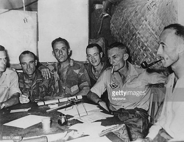 A conference at the French military headquarters in Dien Bien Phu Vietnam during the First Indochina War March 1954 From left to right André Botella...