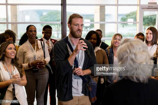 conference attendee asks question during q&a session - town hall meeting stock pictures, royalty-free photos & images