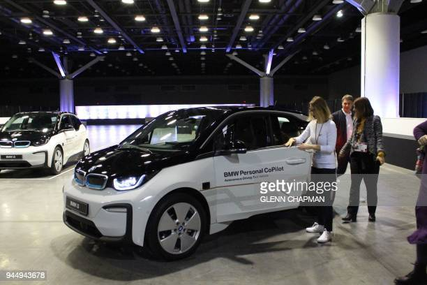TED Conference attendees board a selfdriving BMW car for a ride in Vancouver on April 11 2018 The annual TED Conference is attended by thousands of...