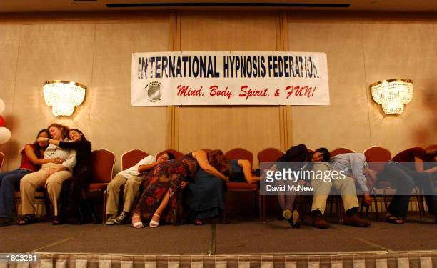 Conference attendees under hypnotic suggestion believe they are sleeping with their favorite teddy bear at the International Hypnosis Federation''s...