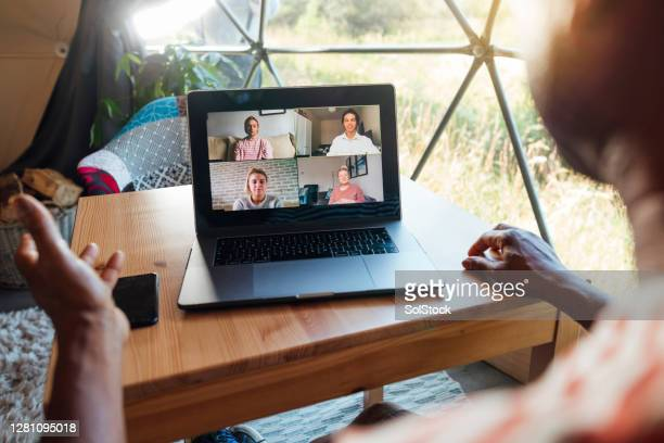 conference call with his employees - simple living stock pictures, royalty-free photos & images