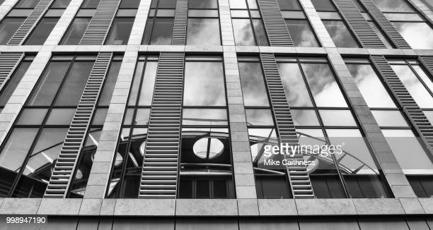 conference centre reflection - mike caithness stock pictures, royalty-free photos & images