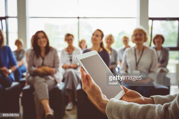 conference for businesswomen - auditorium stock pictures, royalty-free photos & images