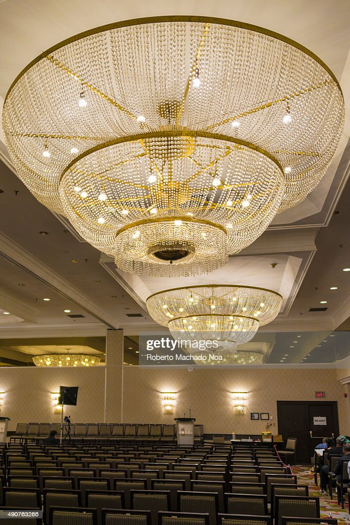 Conference hall with big chandeliers and several rows of pictures conference hall with big chandeliers and several rows of vacant chairs there is a dais mozeypictures Choice Image