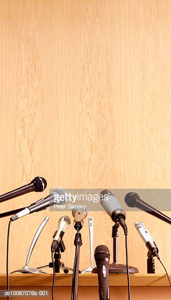 conference microphones on lectern - press conference stock pictures, royalty-free photos & images