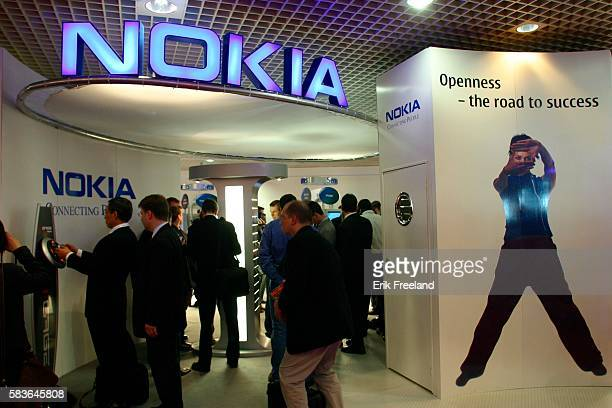 Conference participants visit the Nokia booth at the 3 GSM World Congress Photo by Erik Freeland/Corbis SABA