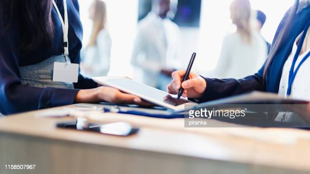 conference reception - signing stock pictures, royalty-free photos & images