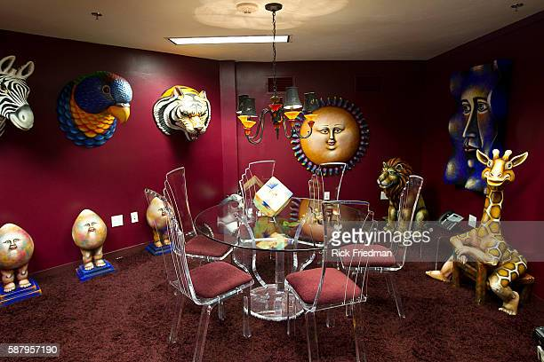 A conference room created by Mexican artists carlos and Albert at the Judge Rotenberg Center The table chairs and most of the art is one of a kind...