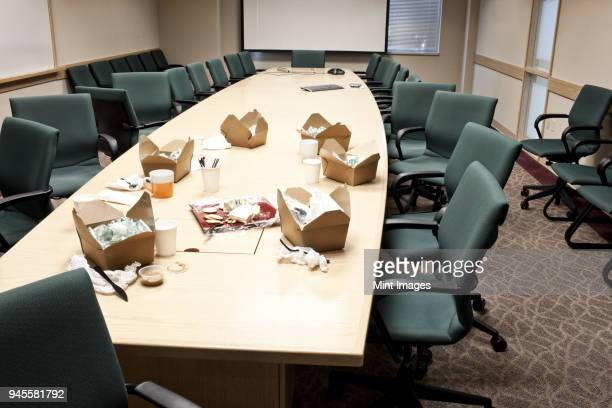 Conference room table with take out lunches