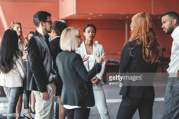 conference room with business people on coffee break - event stock pictures, royalty-free photos & images