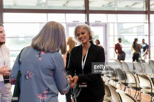 conference speaker greets guest - speaker_(politics) stock pictures, royalty-free photos & images