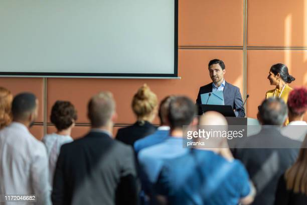 conference speech - summit meeting stock pictures, royalty-free photos & images