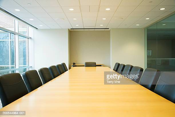 conference table in boardroom - tavolo da conferenza foto e immagini stock