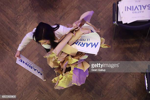 Conference worker unwraps placards with the names of European right-wing leaders in order to place themon chairs prior to a conference of European...